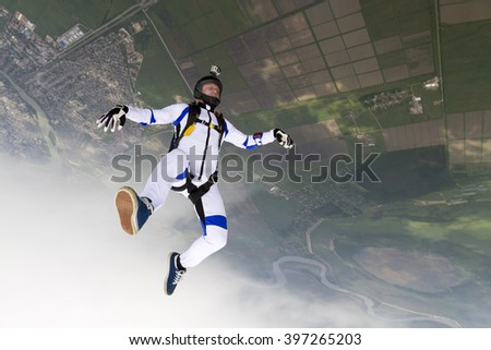 Parachutist in the head-down position. - stock photo