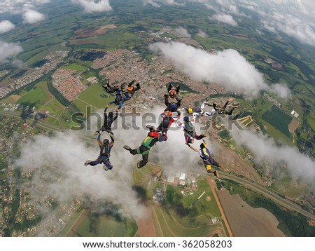 Parachutists performing a 1K formation, meaning one thousand, in Brazil - stock photo