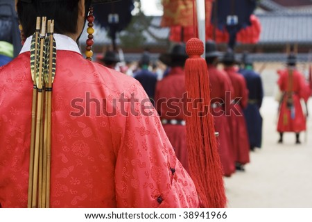 Parade at a Korean Palace for tourist.  Actors are dressed up in traditional costume to show how the emperor of Korea might've lived. - stock photo