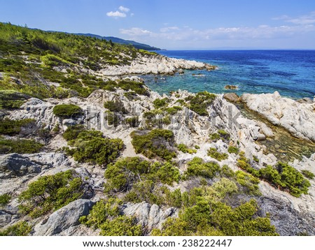 Paradise bay beach, untouched nature abstract archipelago in seashore with rocks in water on peninsula Halkidiki, Greece - stock photo