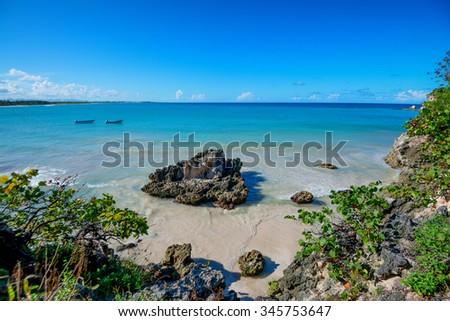 Paradise beach during sunny day on tropical ocean coastline - stock photo