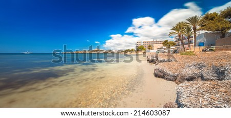 Paradise beach in Ibiza island with blue sky and crystal water - stock photo