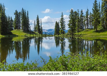 Paradise Divide, small reflecting lake at the pass, near Crested Butte, Colorado in the Rocky Mountains - stock photo