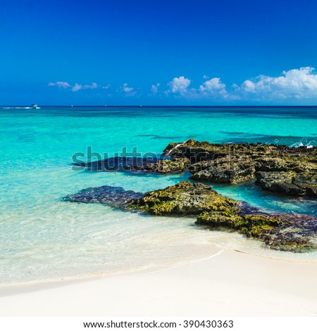Paradise nature, sand, sea water, rocks and summer on the tropical beach.  Playa Del Carmen, Mexico. - stock photo