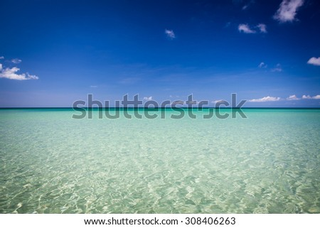 Paradise sand beach on sunny day - stock photo