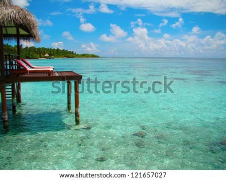 Paradise view from a Maldives water villa - stock photo