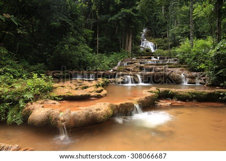 Paradise waterfall in Tropical rain forest of Thailand , water fall in deep forest at border of Chaing rai and phayao province Thailand . The waterfall named Pha Charoen waterfall - stock photo