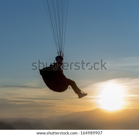 Paraglider at sunset - Kamchatka, Russia - stock photo