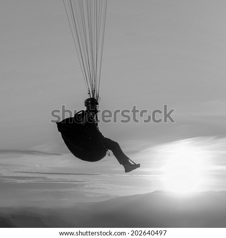 Paraglider at sunset - Kamchatka, Russia (black and white) - stock photo