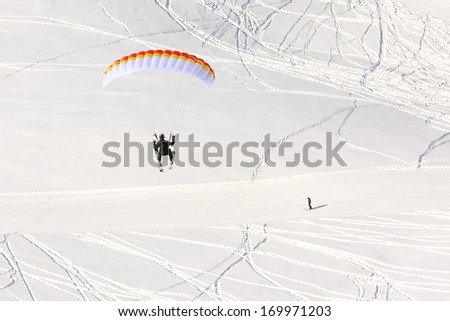 Paraglider in winter Caucasus mountains in Georgia - stock photo