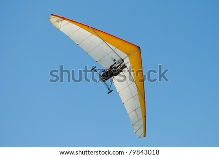 Paraglider on a Blue Sky - stock photo