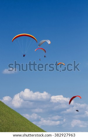 Paraglider. Parachuter. Paragliding in mountains. Paragliding sport.Parachute jumper.Parachute. Extreme sports activit - stock photo