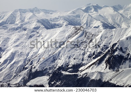 Paragliders of snowy mountains. Caucasus Mountains. Georgia, ski resort Gudauri. - stock photo