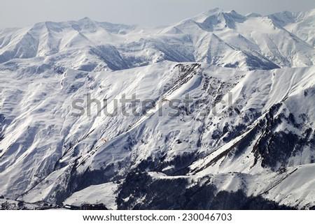 Paragliders of snowy mountains. Caucasus Mountains. Georgia, ski resort Gudauri. - stock photo