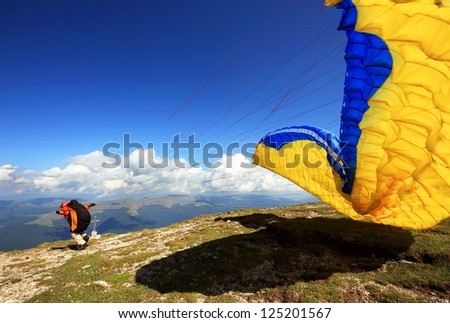 Paragliders prepareing for the flight - stock photo