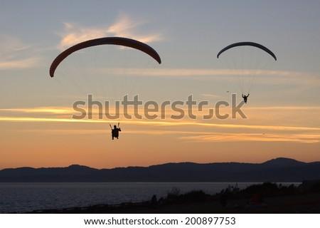 Paragliders, Victoria, BC, Canada - stock photo