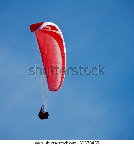 Paragliding in the blue skies of Germany - stock photo