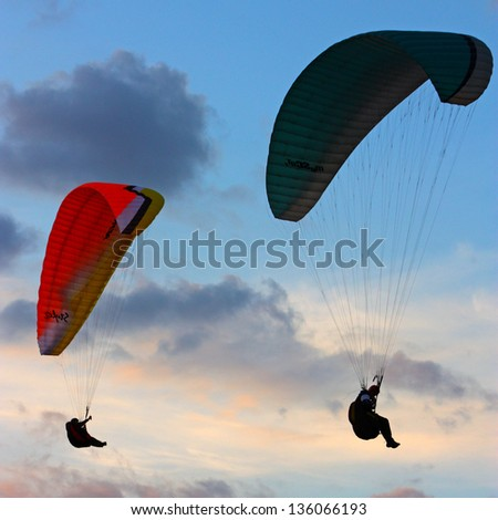 Paragliding on the sunset, taken in September, Crimea, Ukraine - stock photo