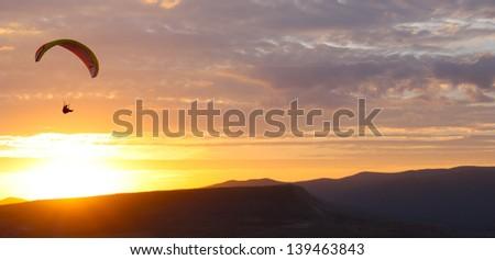Paragliding on the sunset, taken in September, Crimea, Ukraine - stock photo