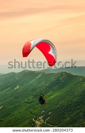 Paragliding solo - stock photo