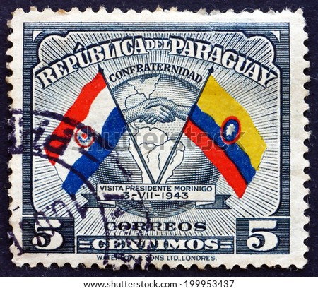 PARAGUAY - CIRCA 1945: a stamp printed in Paraguay shows Handshake, Map and Flags of Paraguay and Colombia, Goodwill Visit of President Higinio Morinigo, circa 1945 - stock photo