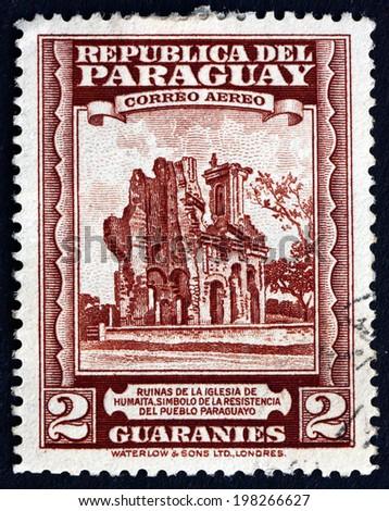 PARAGUAY - CIRCA 1945: a stamp printed in Paraguay shows Ruins of Humaita Church, circa 1945 - stock photo