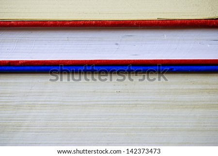 Parallel blue and red books cover closeup, education or literary concept - stock photo
