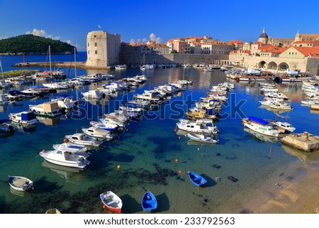 Parallel rows of small boats in the harbor of the old town of Dubrovnik, Croatia - stock photo