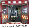 Paramedic's truck with open back doors, where stretcher and medical equipment is visible. All trademarks, names and identifications removed. - stock photo