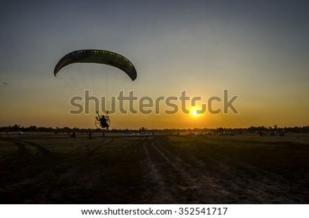 Paramotor flying on the sky - stock photo