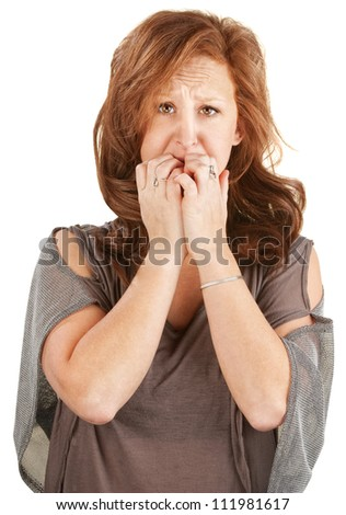 Paranoid European woman with hands over her mouth - stock photo