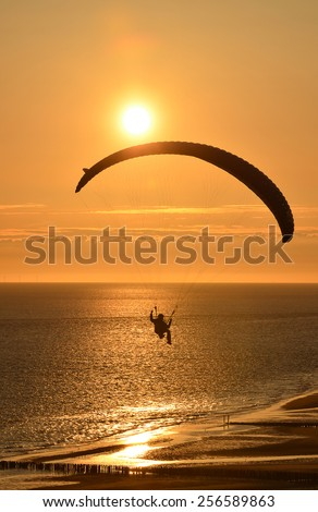 Parapending on the beach of Zoutelande, the only south beach of the Netherlands  - stock photo