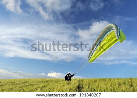 Paraplending at sunset with  sky and cloud - stock photo