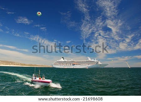 Parasailing on a beautiful day - stock photo
