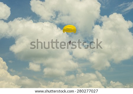 Parasailing over the blue waters of the Andaman Sea - stock photo