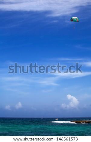 Parasailing over the sea water, Riviera Maya - stock photo