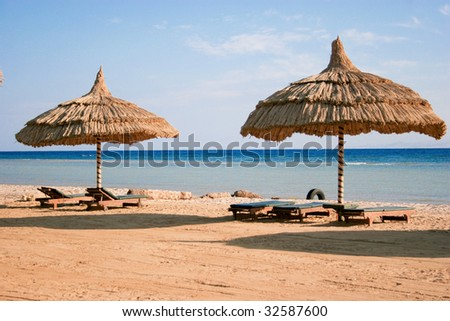 parasols on the beach - stock photo
