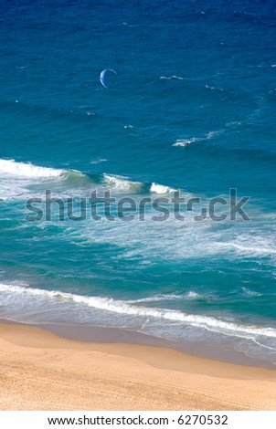 Parasurfing on a beautiful day by the ocean beach - stock photo