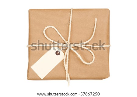 Parcel tied with string with label attached on white background - stock photo