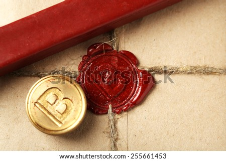 Parcel with wax seal, close up - stock photo
