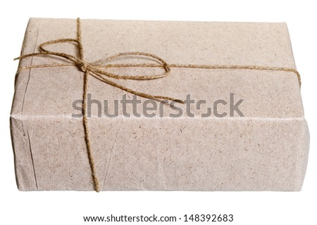parcel wrapped in brown paper and tied with twine - stock photo