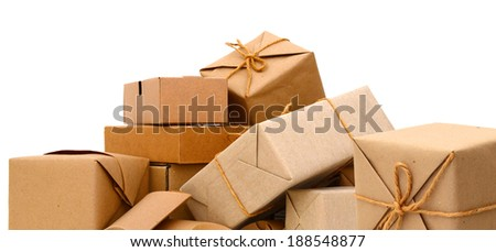 parcel wrapped packaged boxes isolated on white background  - stock photo