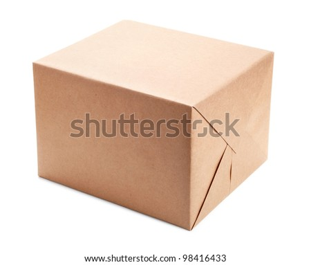 Parcel wrapped with brown packing paper isolated on white - stock photo