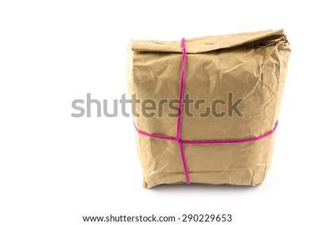 Parcel wrapped with brown paper, tied with pink string isolated on white background prepare to send - stock photo