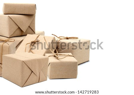 parcels boxes with wrapping paper, isolated on white - stock photo