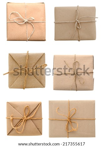 Parcels tied with rough twine, above view  - stock photo
