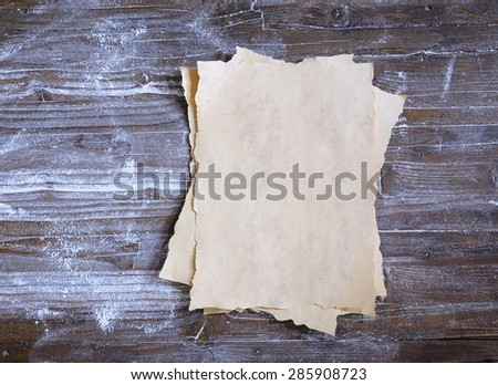 Parchment on wooden table in the kitchen. - stock photo