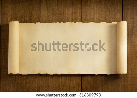 parchment scroll on wooden background - stock photo