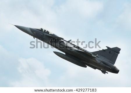 PARDUBICE, CZECH REPUBLIC - 29 May 2016:  Aircraft JAS 39C Gripen in aviation fair and century air combats, Pardubice, Czech Republic on 29 May 2016 - stock photo