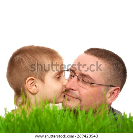 parent kid  kiss father's day green grass white background - stock photo